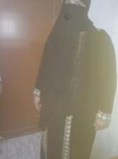 بالصورة ...ضبط متسول يتنكر بزي منقبة امتهن التسول ونشل النساء بصلاة التراويح في إربد