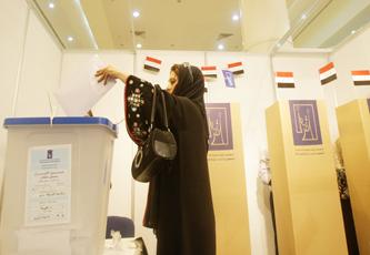 العراقيون في الأردن يتوجهون إلى مراكز الاقتراع للتصويت في انتخاباتهم التشريعية