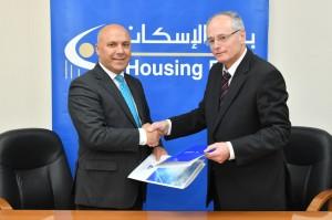 بنك الإسكان يوقع اتفاقية تعاون وشراكة مع صندوق تشجيع الطاقة المتجددة وترشيد الطاقة