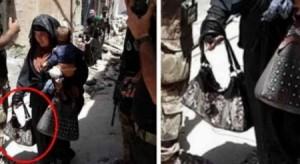 صور صادمة .. أم داعشية تفجر نفسها وطفلها في الموصل