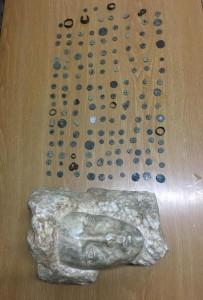 القبض على شخص بحوزته راس تمثال و143 قطعة اثرية قديمة