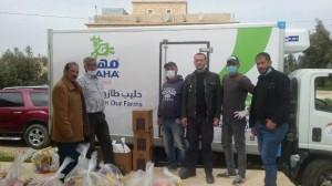 شركة الالبان الاردنية بالتعاون مع جمعية الكوم الأحمر للتنمية الاجتماعية توزع طرود غذائية  للأسر المحتاجة