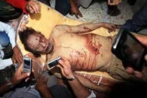 """ذي تايمز"""" تصف لحظة بلحظة كيف قتل """"القذافي"""""""
